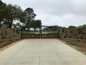 new automatic gate with a stone wall in fort worth
