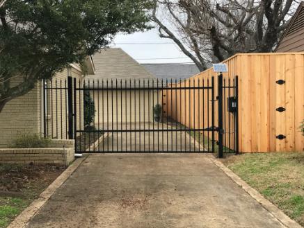 Short black metal gate in Southlake Texas