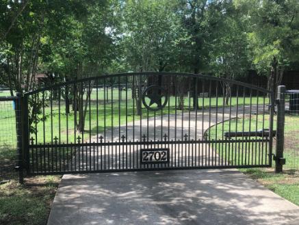 New gray metal electric gate repair in dallas