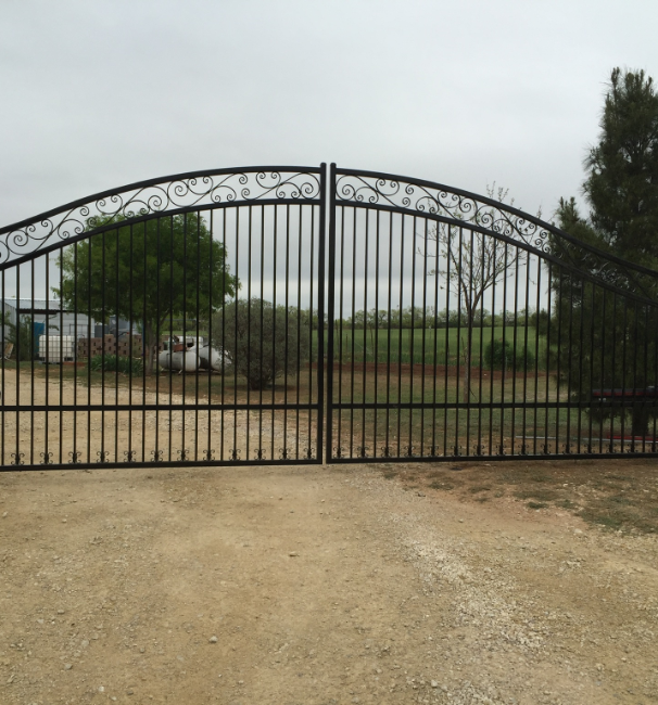 black metal gate with a design on the top